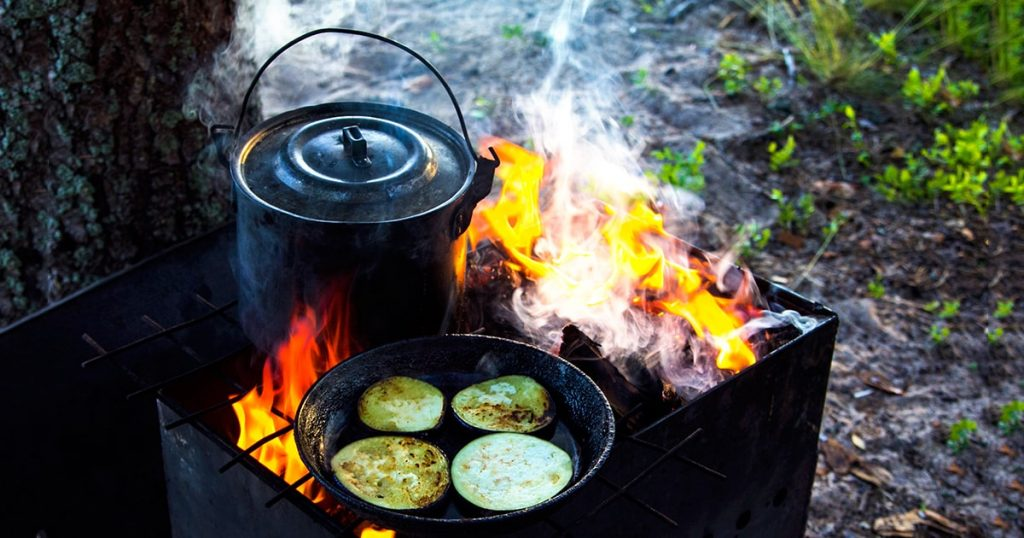 Cooking over an open fire in the forest