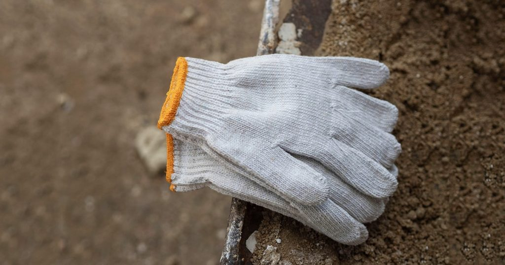 White fabric gloves on background