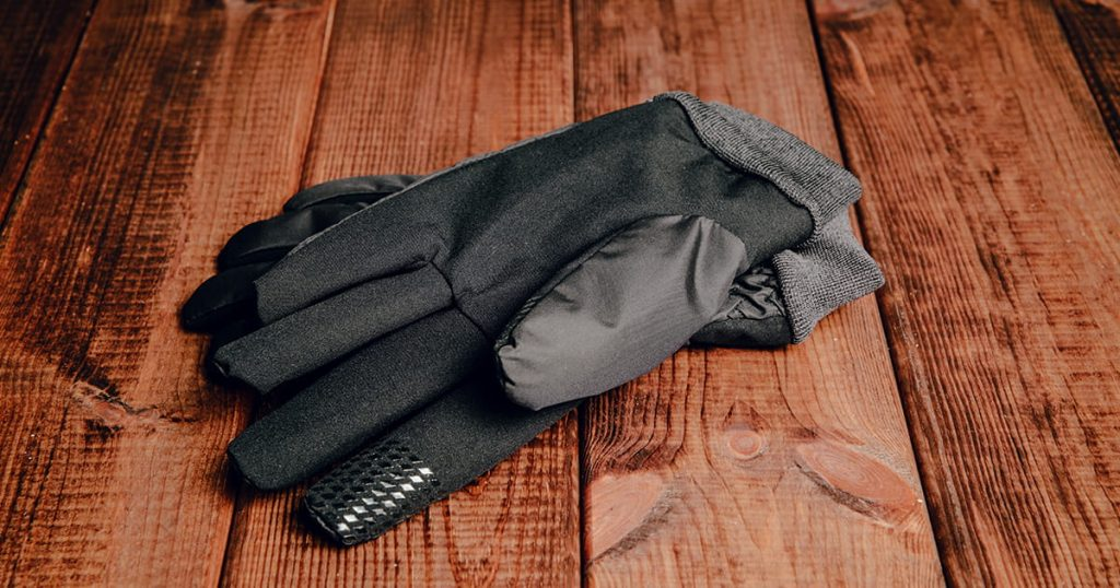 Winter gloves on wooden table